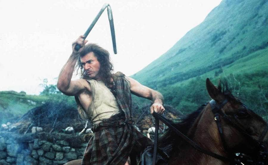 Mel Gibson waving num-chuks around the air while riding a horse in the film Braveheart