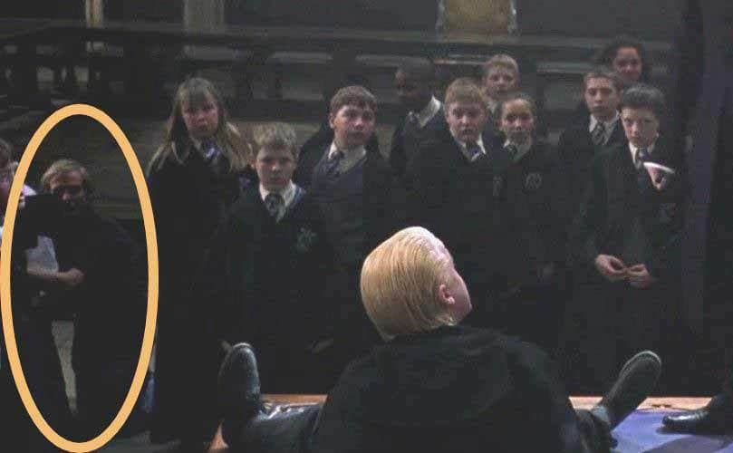 Malfoy on the ground in a scene from Harry Potter and the Chamber of Secrets with the camera man in the background