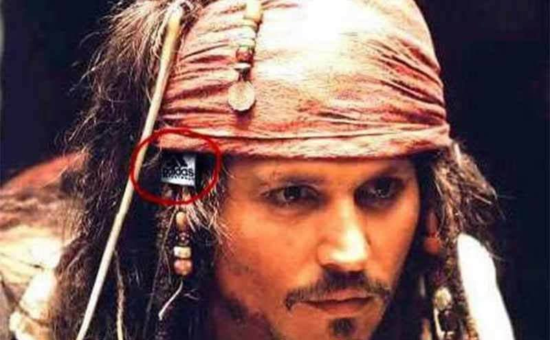 Johnny Depp with an adidas tag sticking out of his head scarf