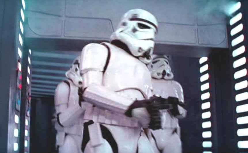 The Stormtroopers walking through a doorway with one of them running into the top of the door frame