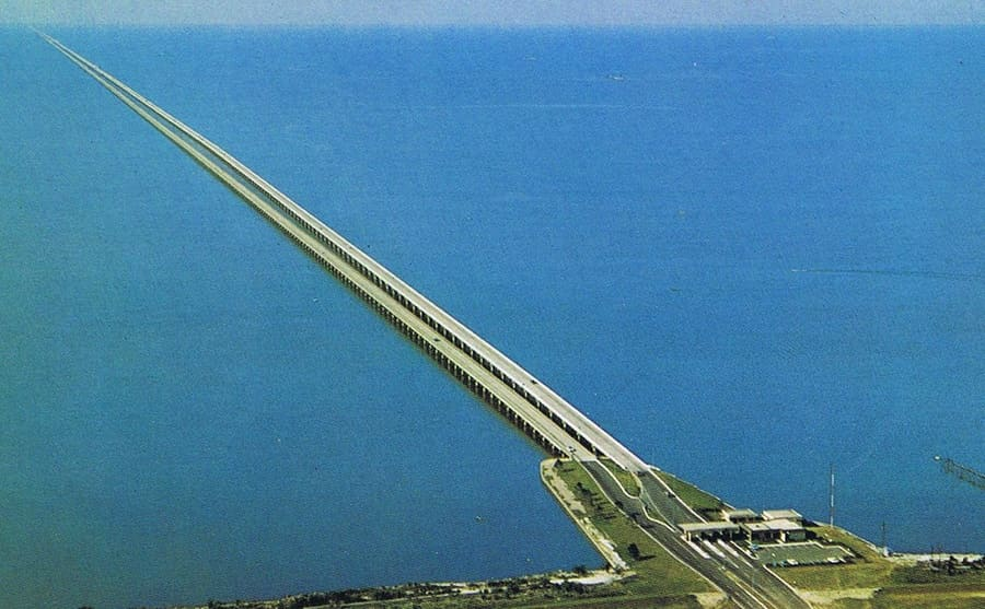 An aerial view of Lake Pontchartrain Causeway going out into the ocean
