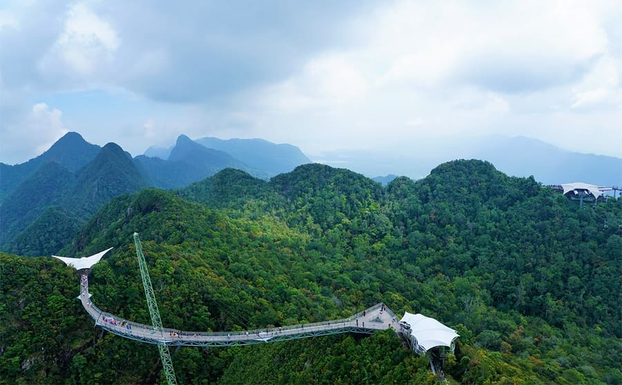 The Langkawi Sky Bridge across green covered mountains