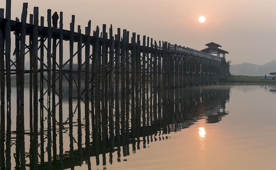 The tall wooden U Bein Bridge over the water