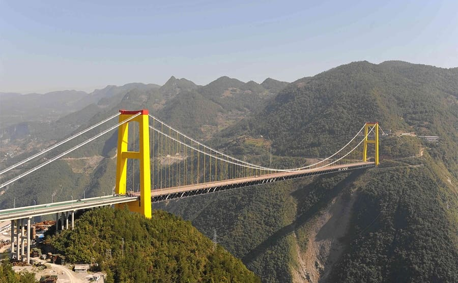A large bridge with two yellow peaks