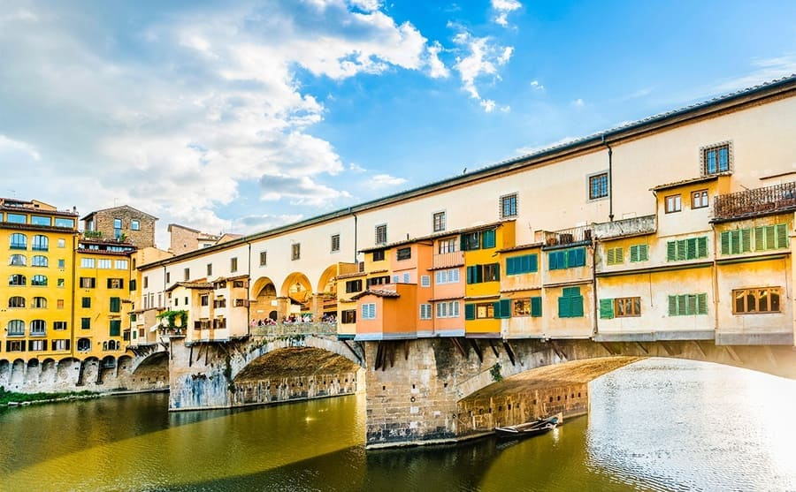 The Ponte Vecchio Bridge with small colorful houses and windows along it
