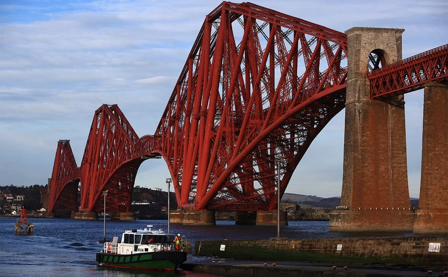 The Forth Rail Bridge with a boat in the water