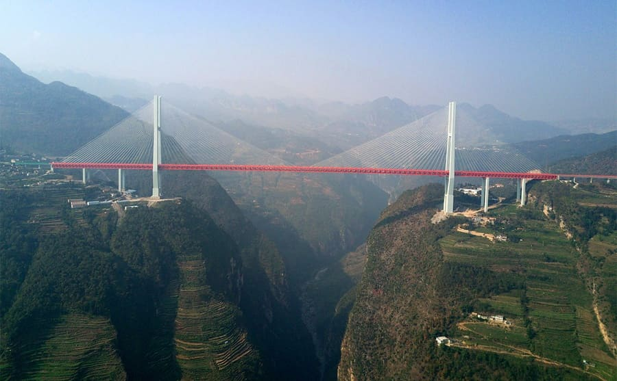 The Beipanjiang Bridge suspended over a canyon
