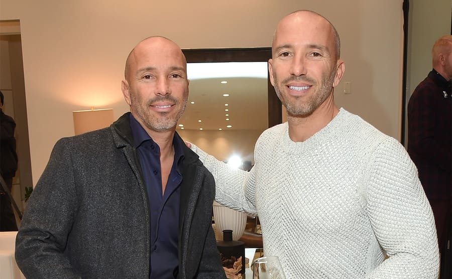 Brett and Jason Oppenheim posing together at an event