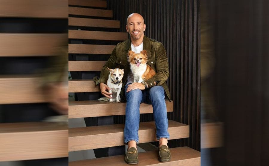 Jason posing with his two dogs