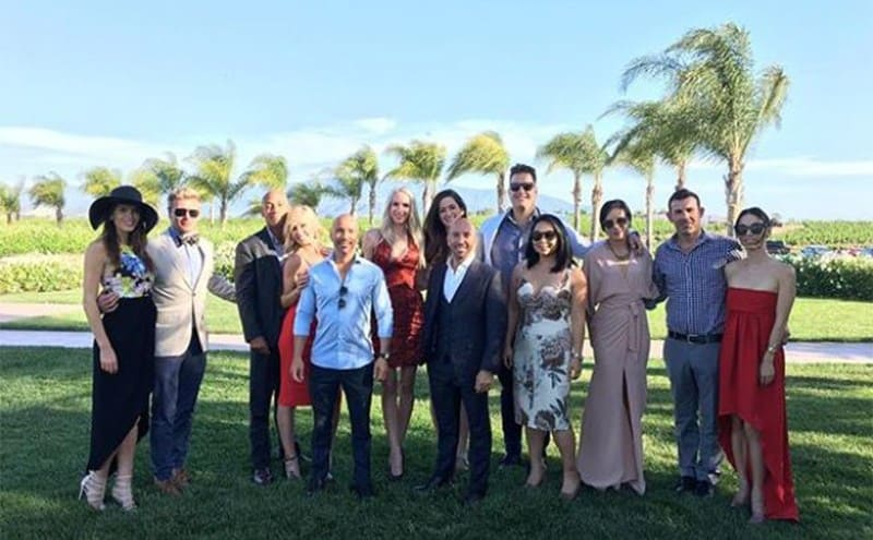 Brett and Jason with the rest of the crew posing at a wedding