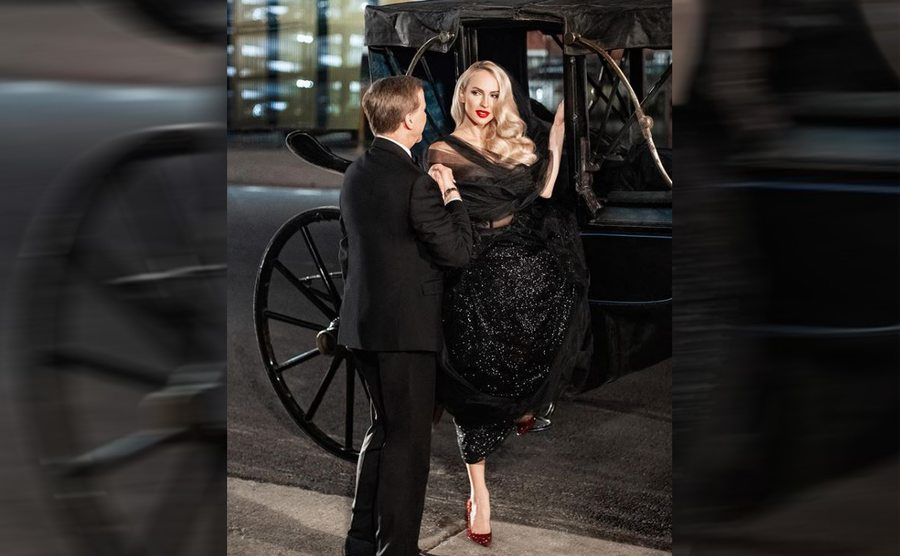 Christine Quinn coming out of the carriage wearing her black shiny wedding dress