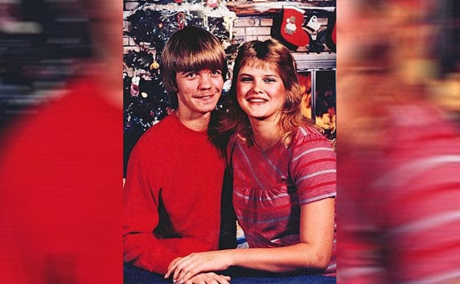 Anna Nicole and Billy Wayne Smith posing by the Christmas tree