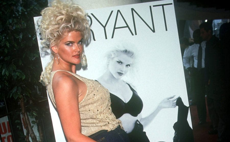 Anna Nicole posing in front of her Lane Bryant's new plus-size jeans line ad