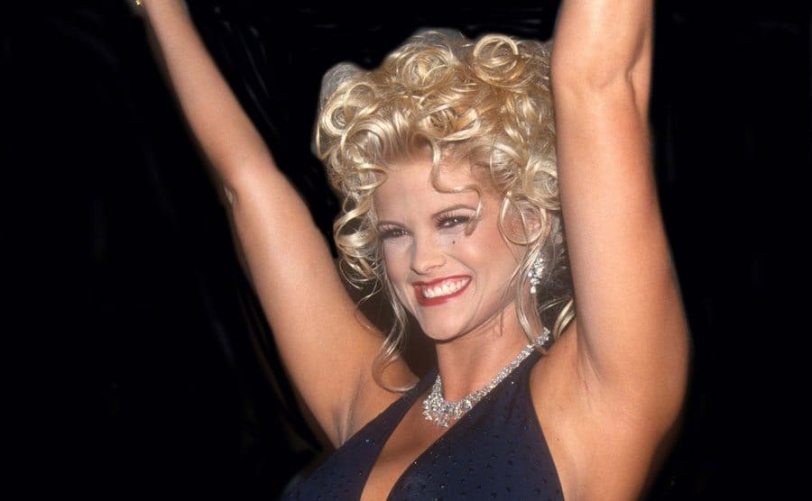 Anna Nicole Smith throwing her hands in the air posing in 1993