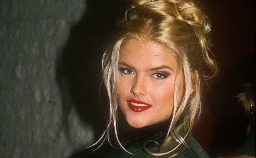 Anna Nicole Smith posing at Frank Sinatra's 80th birthday party in 1994