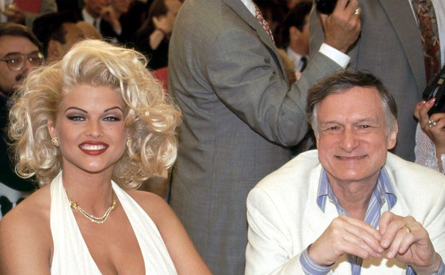 Anna Nicole Smith and Hugh Hefner at a red carpet event in 1993