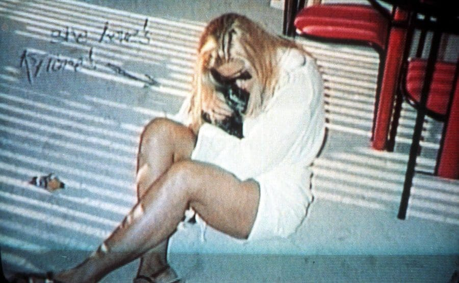 Anna Nicole Smith sitting on the ground after a long night of partying circa 1994