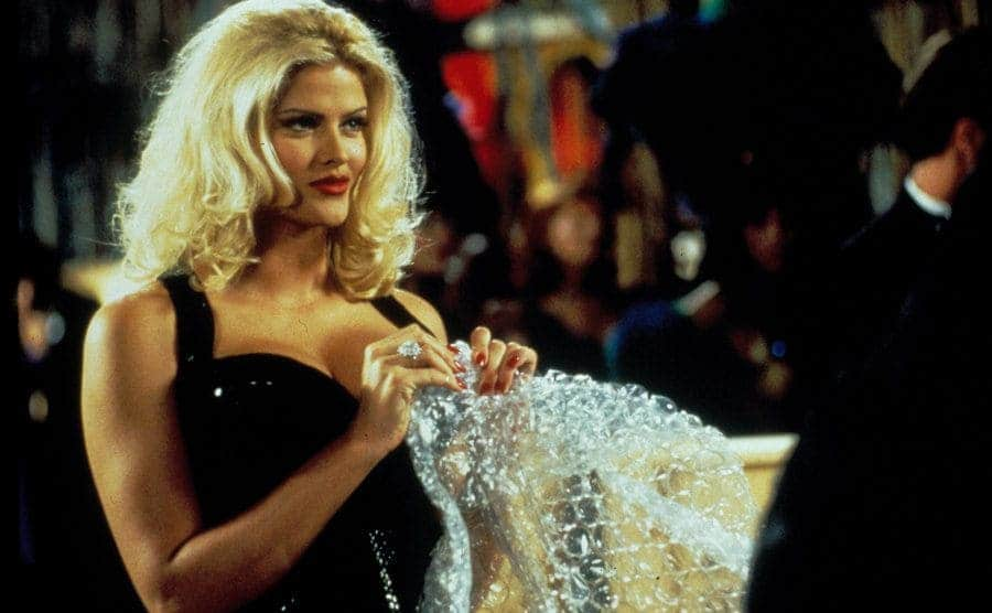 Anna Nicole Smith popping bubble wrap in a scene from Naked Gun 33 1/3