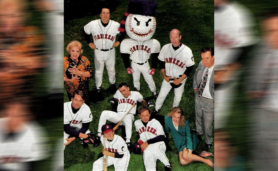 Joe Rogan as Frank Valente surrounded by the other actors in Hardball