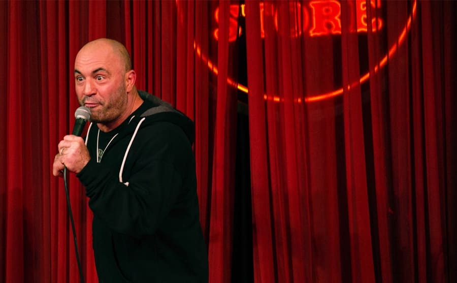 Joe Rogan performing on stage at the Comedy Store