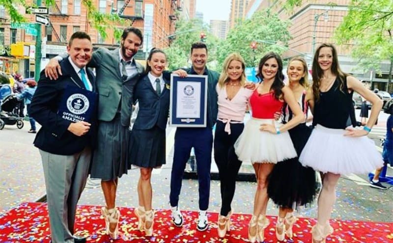 Kelly Ripa posing with other dancers, Ryan Seacrest, and the man who watched over the world record being broken