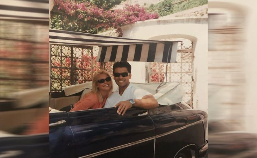Kelly and Mark in a convertible while on their honeymoon in 1996