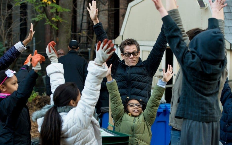 Kevin Bacon with children Kevin Bacon visits Harlem Growth Farm, New York