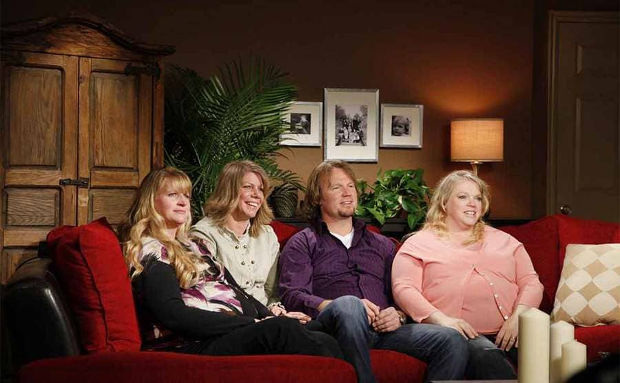 Kody Brown sitting with Christine, Meri, and Janelle on the red sofa used during show interviews