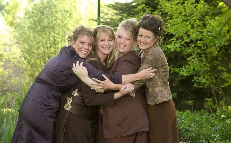 All four sister wives hugging for a photograph