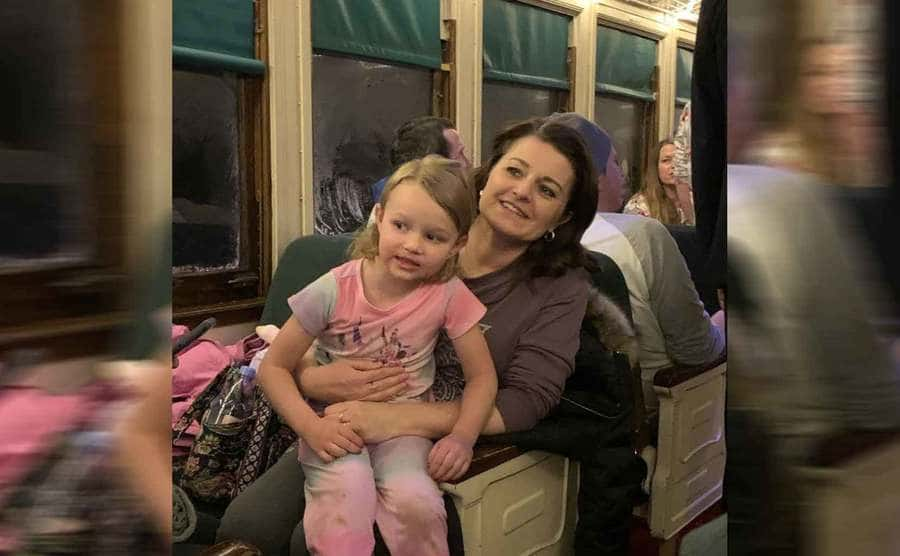 Robyn on a train with one of their daughters