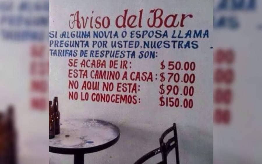 Un aviso de bar que anuncia las diferentes tarifas a sus diferentes respuestas, por si alguna novia o espasa llama a sus clientes