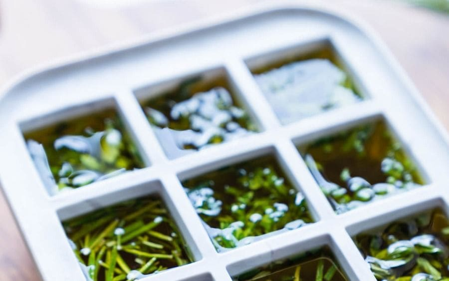 Fresh herbs in the ice cube tray