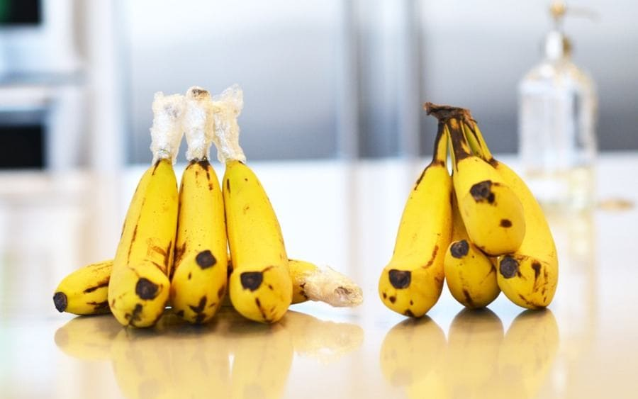 Bananas wrapped in plastic