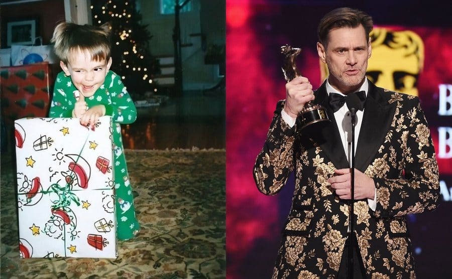 Jim Carrey when he was a child making a face with his thumb up holding a Christmas present in his living room / Jim Carrey accepting a Britannia Award on stage in a gold-embroidered suit