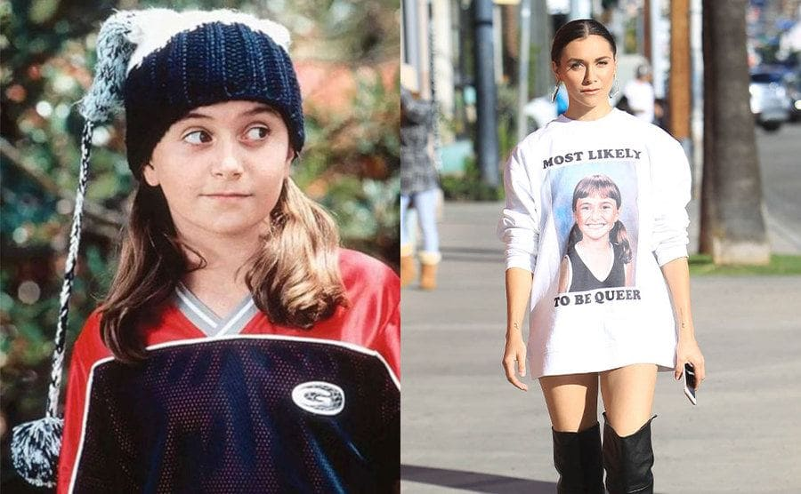 Alyson Stoner in a fuzzy hat and a sports jersey when she was younger / Alyson Stoner walking down the street in 2018 wearing a sweater with her face on it and 'Most Likely to be Queer.'
