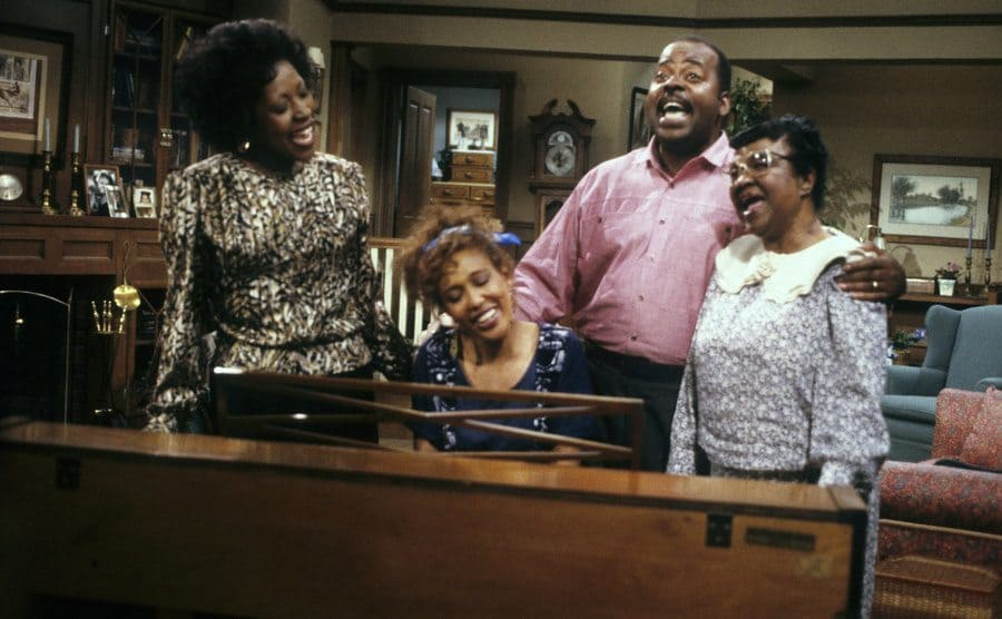 Reginald Vel Johnson, Jo Marie Payton, Rosetta LeNoire, and Telma Hopkins around the piano singing together