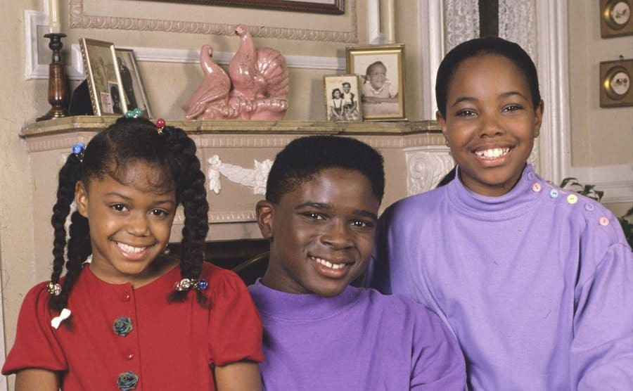 Jaimee Foxworth, Darius McCrary, and Kellie Shanygne Williams posing together on an armchair in Family Matters