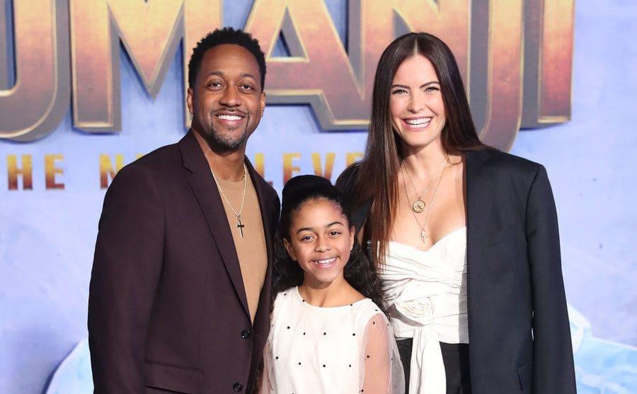 Jaleel White, Samaya White, and Bridge Hardy posing together on the red carpet