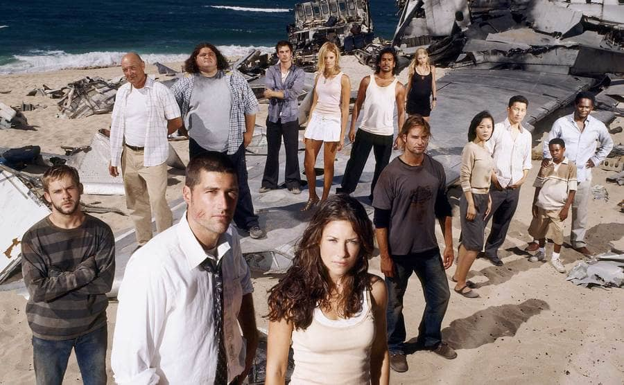The actors of season one standing on the beach looking at the camera