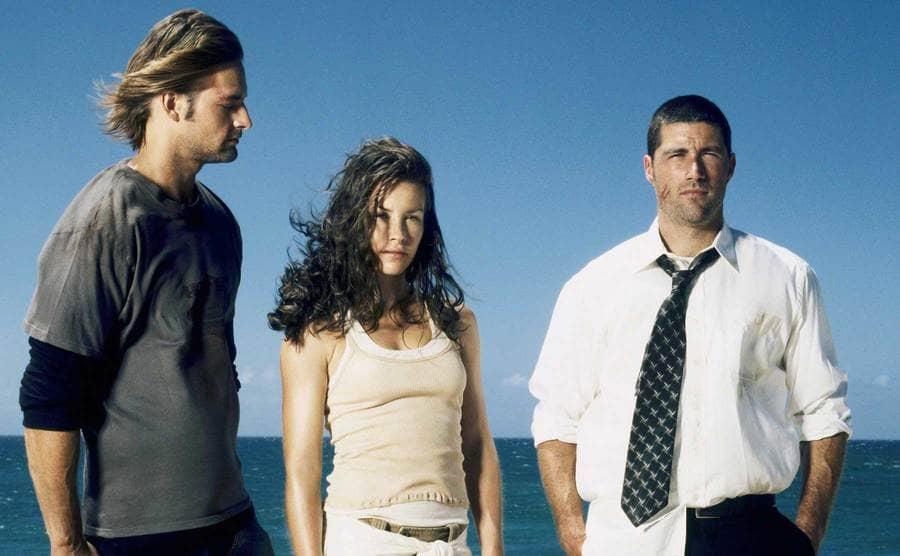 Matthew Fox, Evangeline Lilly, and Josh Holloway standing on the beach
