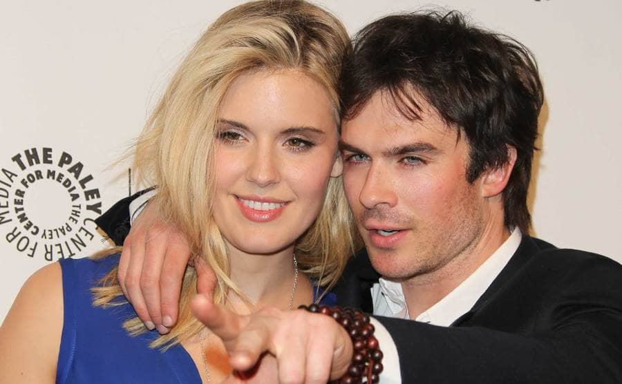 Ian Somerhalder pointing while posing with Maggie Grace on the red carpet