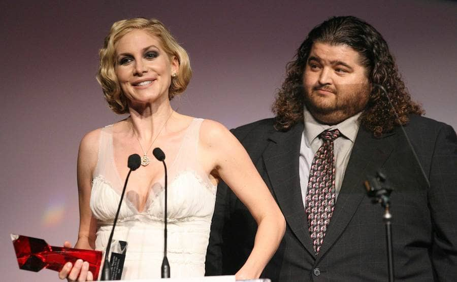 Elizabeth Mitchell and Jorge Garccia on stage in front of microphones