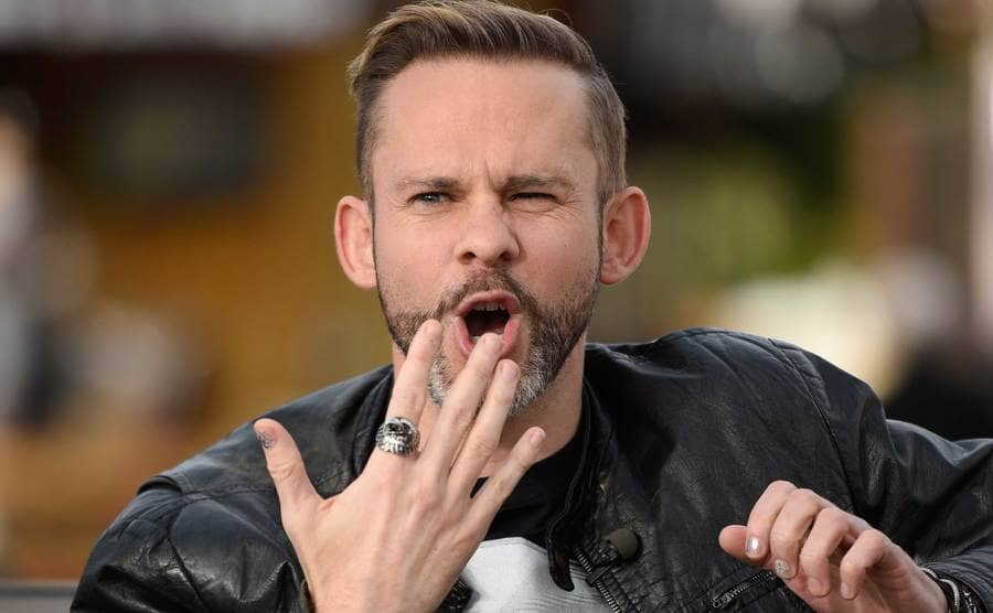 A close up of Dominic Monaghan winking