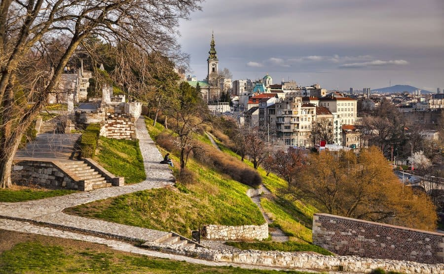 A view of Serbia with houses built on the mountainside and beautiful stone paths along with it