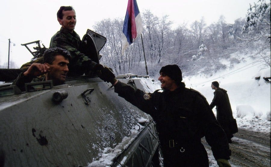 Members of the Serbian army around a tank