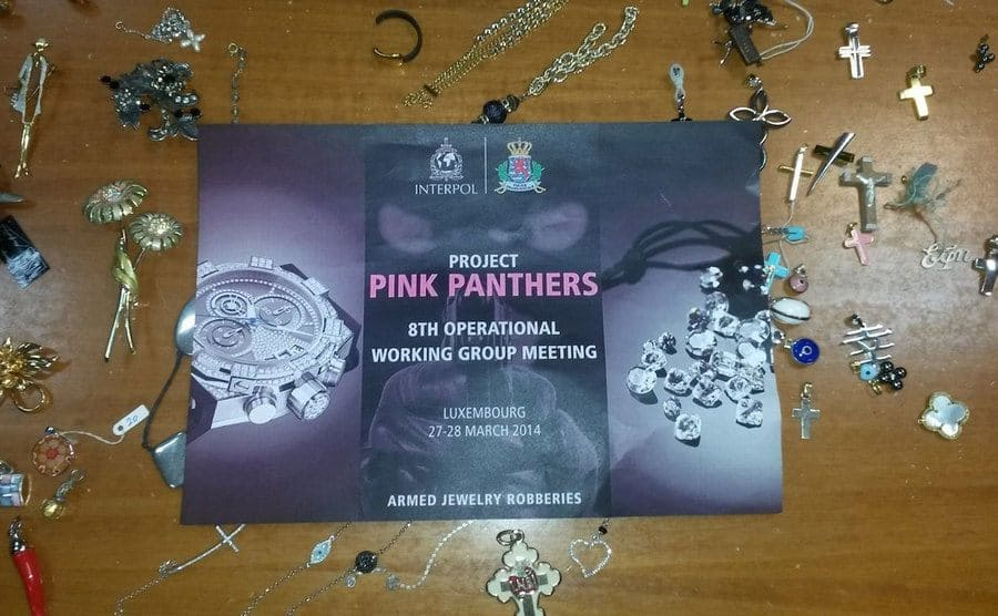 A flyer for Project Pink Panther from Interpol with randomly stolen necklaces around it