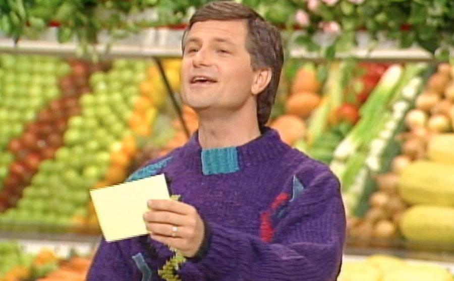 David Ruprecht reading a question off of a card.