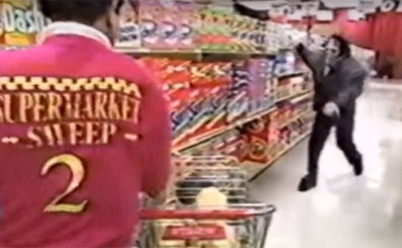A market monster running at a scared Supermarket Sweep contestant in the aisle while filming.