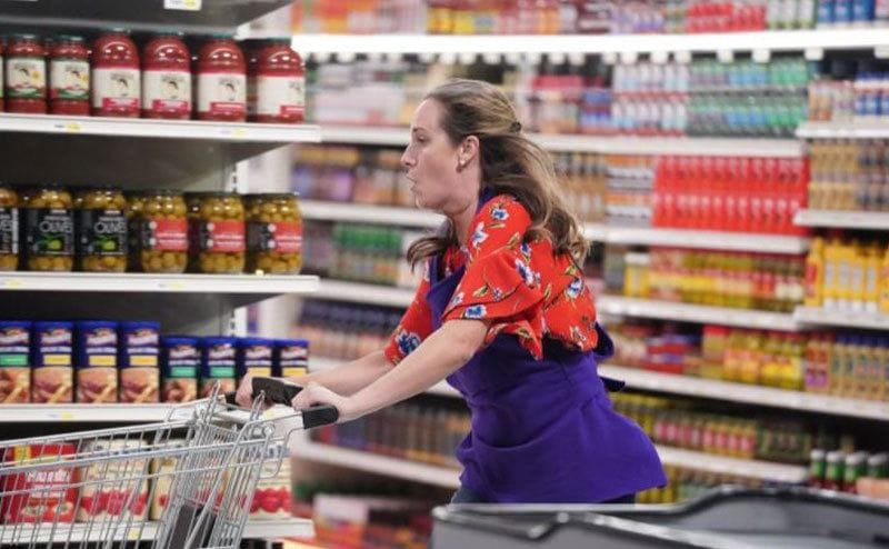 A Supermarket Sweep reboot contestant pushing her cart furiously through the set. She better be careful.