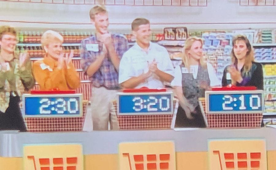 The young Kevin and Brandon on set towering over the older contestants around them.